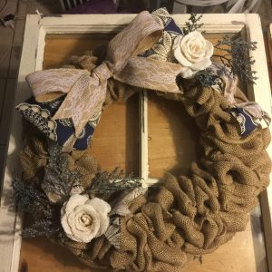 Burlap wreath above old distressed window
